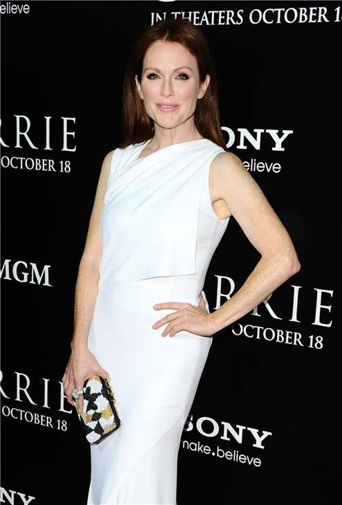Julianne Moore appears in a white Givenchy gown at the premiere of 'Carrie' in Los Angeles, California on Oct. 7, 2013.