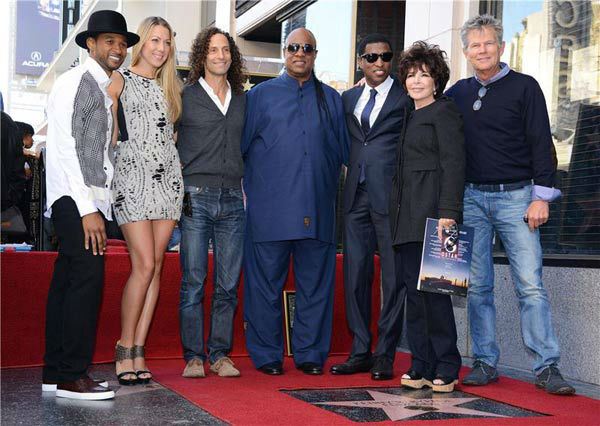 Kenny &#39;Babyface&#39; Edmonds, Usher, Colbie Caillat, Kenny G, Stevie Wonder, Carole Bayer Sager and David Foster appear at the ceremony for Edmonds, who received a star on the Hollywood Walk of Fame on Oct. 10, 2013. <span class=meta>(Lionel Hahn&#47;Abacausa&#47;startraksphoto.com)</span>
