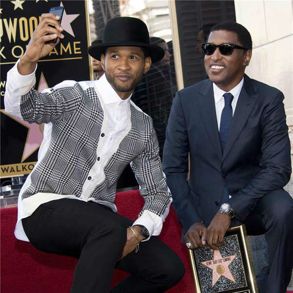 Usher appears with Kenny &#39;Babyface&#39; Edmonds, who received a star on the Hollywood Walk of Fame on Oct. 10, 2013. <span class=meta>(Lionel Hahn&#47;Abacausa&#47;startraksphoto.com)</span>