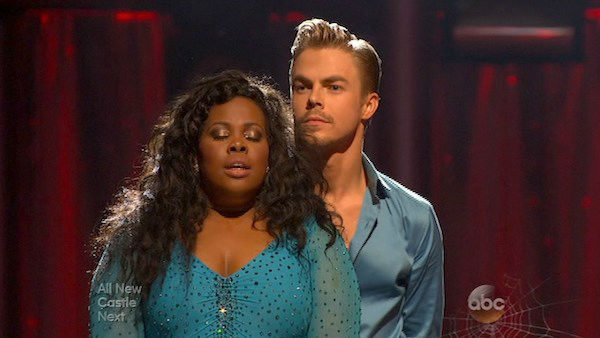 Amber Riley and Derek Hough await their fate on week six of &#39;Dancing With The Stars&#39; on Oct. 21, 2013. They received 28 out of 30 points from the judges for their Samba. The two received 4 out of 4 extra points from the &#39;Switch-Up Challenge.&#39; <span class=meta>(ABC Photo)</span>