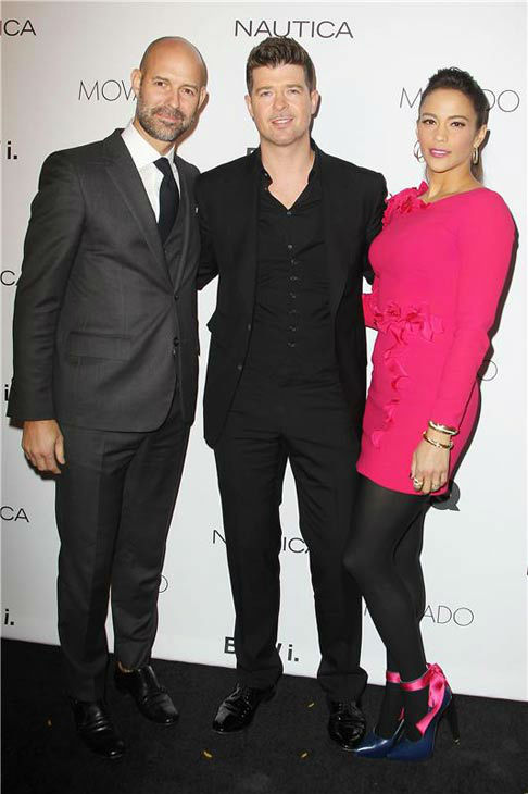 Robin Thicke and Paula Patton appear with GQ VP and Publisher Chris Mitchell at the 2013 GQ Gentlemen's Give Back Ball in New York City on Oct. 23, 2013.
