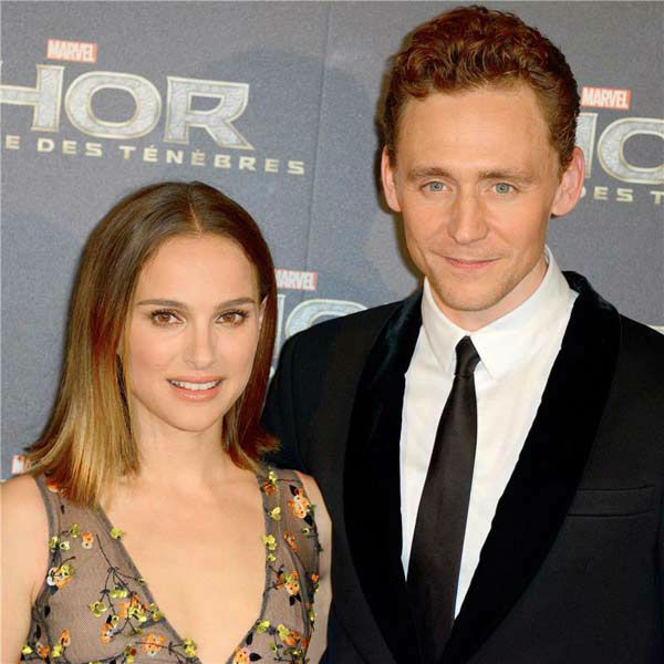 Natalie Portman and Tom Hiddleston appear at the premiere of 'Thor: The Dark World' in Paris on Oct. 23, 2013.