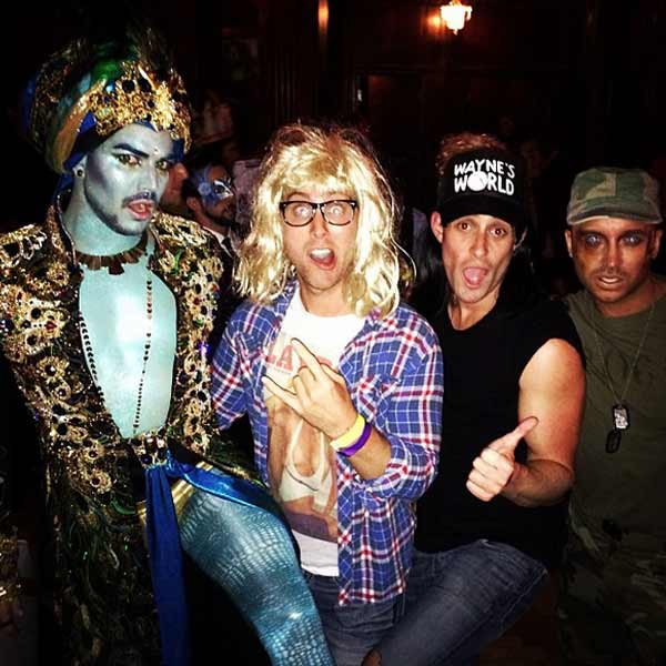 Adam Lambert dressed as a Genie, Lance Bass and fiance Michael Turchin as Garth and Wayne from the movie 'Wayne's World' and former 'Queer Eye for the Straight Guy' host Jai Rodriguez as an Army man at a Halloween party on Oct. 26, 2013.