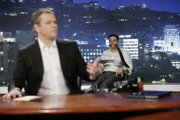 Damon sits in Jimmy Kimmel's desk chair as the host appears bound and gagged behind him on ABC's 'Jimmy Kimmel Live!,' renamed 'Jimmy Kimmel Sucks,' after Damon hijacked the show on Jan. 24, 2013.