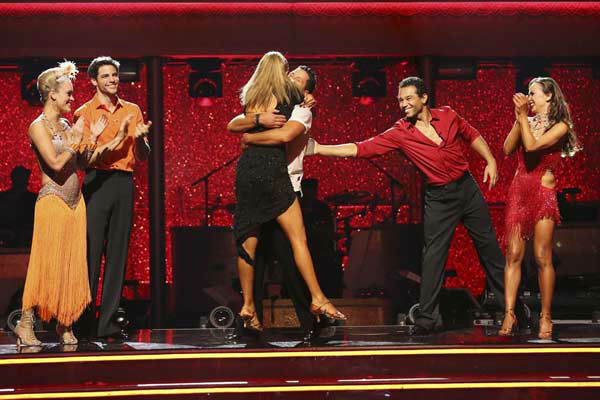 Elizabeth Berkley and Val Chmerkovskiy react to being safe on week eight of 'Dancing With The Stars' on Nov. 4, 2013.