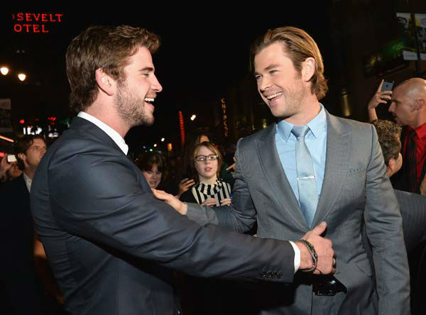 Liam and Chris Hemsworth appear at the 'Thor: The Dark World' premiere in Los Angeles, California on Nov. 4, 2013.