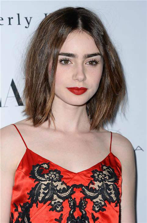 Lily Collins appears at the Flaunt Magazine November issue party in Los Angeles on Nov. 7, 2013. <span class=meta>(Lionel Hahn&#47;AbacaUSA&#47;startraksphoto.com)</span>
