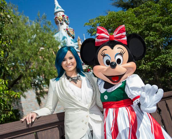 Demi Lovato meets Minnie Mouse during a break from taping the 'Disney Parks Christmas Day Parade' television special at Disneyland in Anaheim, California on Saturday, Nov. 9, 2013. 'Disney Parks Christmas Day Parade' airs Dec. 25, 2013 on ABC.