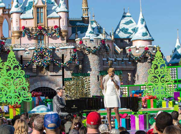 Mary J. Blige and David Foster perform during a taping for the 'Disney Parks Christmas Day Parade' television special at Disneyland in Anaheim, California on Saturday, Nov. 9, 2013. 'Disney Parks Christmas Day Parade' airs Dec. 25, 2013 on ABC.