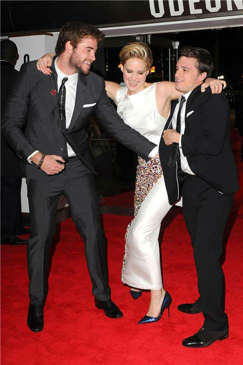Liam Hemsworth, Jennifer Lawrence and Josh Hutcherson joke around at 'The Hunger Games: Catching Fire' U.K. premiere on Nov. 11, 2013.
