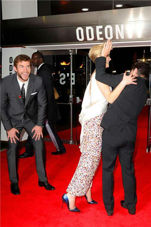 Liam Hemsworth, Jennifer Lawrence and Josh Hutcherson joke around at &#39;The Hunger Games: Catching Fire&#39; U.K. premiere on Nov. 11, 2013. <span class=meta>(Richard Young &#47; startraksphoto.com)</span>