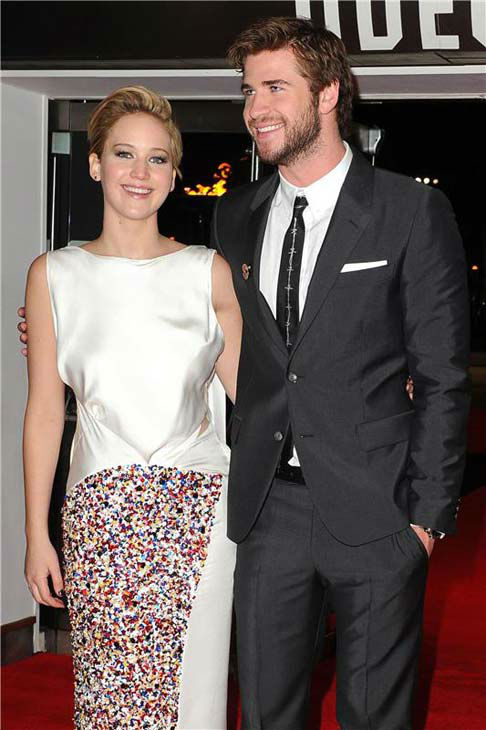 Liam Hemsworth and Jennifer Lawrence appear at 'The Hunger Games: Catching Fire' U.K. premiere on Nov. 11, 2013.