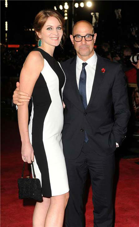 Stanley Tucci and a guest appear at 'The Hunger Games: Catching Fire' U.K. premiere on Nov. 11, 2013.