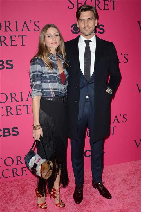 Olivia Palermo and Johannes Huebl appear at the 2013 Victoria's Secret Fashion Show in New York City on Nov. 13, 2013.