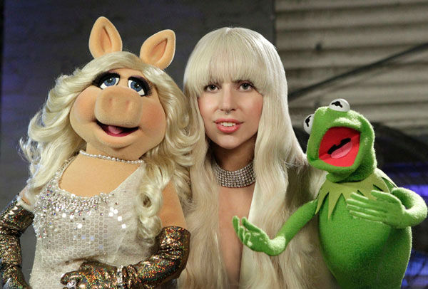 Lady Gaga appears with Miss Piggy and Kermit the Frog in a promotional photo for 'Lady Gaga and The Muppets' Holiday Spectacular,' which airs on ABC on Nov. 28, 2013.