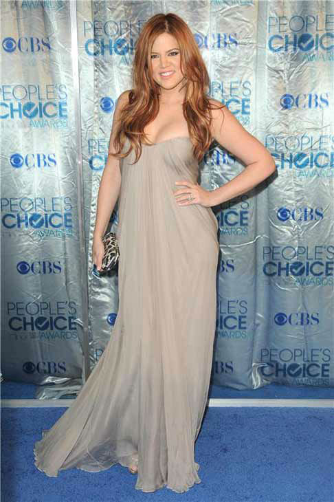 Khloe Kardashian, sporting red hair, appears at the 2011 People&#39;s Choice Awards in Los Angeles, California on Jan. 5, 2011.  <span class=meta>(Kyle Rover &#47; startraksphoto.com)</span>