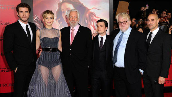 Liam Hemsworth, Jennifer Lawrence, Donald Sutherland, Josh Hutcherson, Philip Seymour Hoffman and Stanley Tucci appear at the Los Angeles premiere of 'The Hunger Games: Catching Fire' on Nov. 18, 2013.
