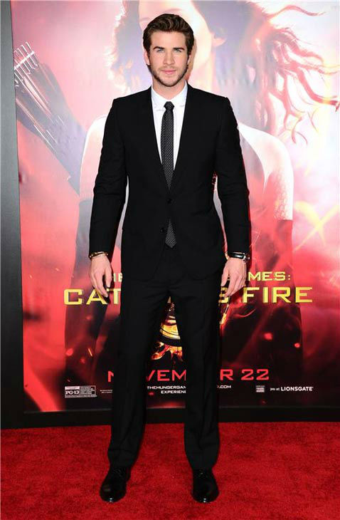 "<div class=""meta image-caption""><div class=""origin-logo origin-image ""><span></span></div><span class=""caption-text"">Liam Hemsworth appears at the Los Angeles premiere of 'The Hunger Games: Catching Fire' on Nov. 18, 2013.   (Sara De Boer / startraksphoto.com)</span></div>"