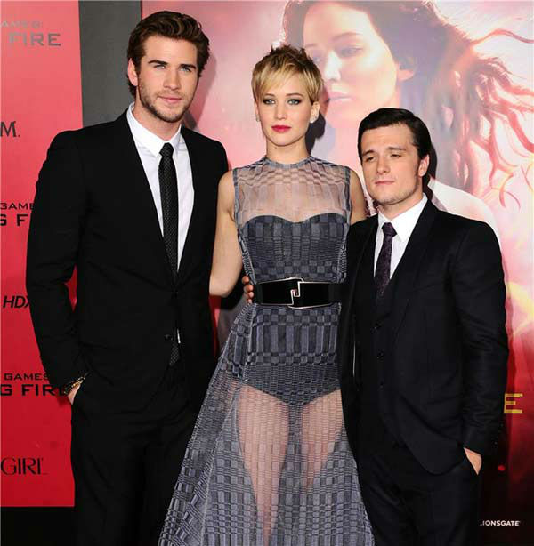 "<div class=""meta image-caption""><div class=""origin-logo origin-image ""><span></span></div><span class=""caption-text"">Liam Hemsworth, Jennifer Lawrence and Josh Hutcherson appear at the Los Angeles premiere of 'The Hunger Games: Catching Fire' on Nov. 18, 2013.   (Sara De Boer / startraksphoto.com)</span></div>"
