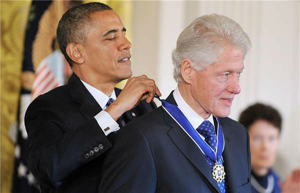 President Barack Obama awards former President Bill Clinton with the Presidential Medal of Freedom, Wednesday, Nov. 20, 2013, during a ceremony in the East Room of the White House in Washington.  <span class=meta>(Olivier Douliery&#47;AbacaUSA&#47;startraksphoto.com)</span>