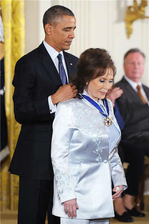 President Barack Obama awards Loretta Lynn with the Presidential Medal of Freedom, Wednesday, Nov. 20, 2013, during a ceremony in the East Room of the White House in Washington.  <span class=meta>(Olivier Douliery&#47;AbacaUSA&#47;startraksphoto.com)</span>