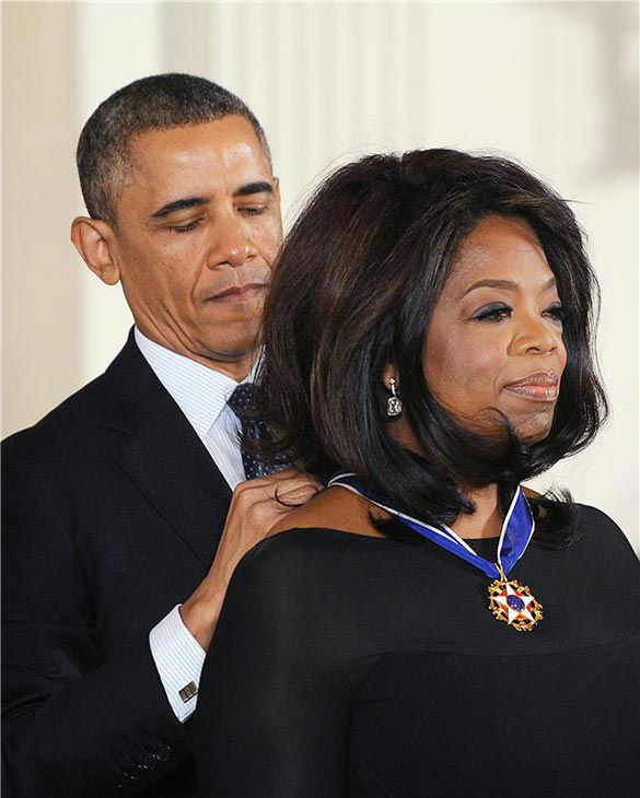 President Barack Obama awards Oprah Winfrey with the Presidential Medal of Freedom, Wednesday, Nov. 20, 2013, during a ceremony in the East Room of the White House in Washington.  <span class=meta>(Olivier Douliery&#47;AbacaUSA&#47;startraksphoto.com)</span>