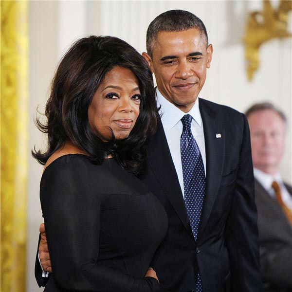 President Barack Obama and Oprah Winfrey appear at the 2013 Presidential Medal Of Freedom ceremony at the White House on Nov. 20, 2013.