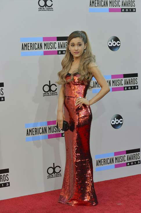 Ariana Grande arrives at the American Music Awards at the Nokia Theatre L.A. Live on Sunday, Nov. 24, 2013, in Los Angeles.