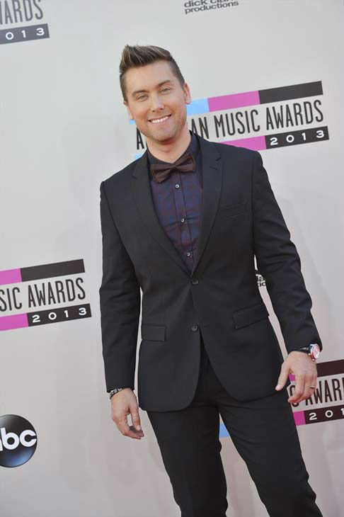 "<div class=""meta image-caption""><div class=""origin-logo origin-image ""><span></span></div><span class=""caption-text"">Lance Bass arrives at the American Music Awards at the Nokia Theatre L.A. Live on Sunday, Nov. 24, 2013, in Los Angeles. (ABC Photo/Richard Harbaugh)</span></div>"