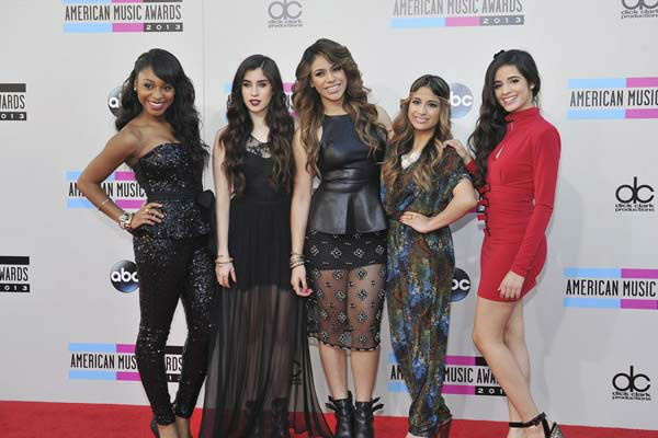 Fifth Harmony arrives at the American Music Awards at the Nokia Theatre L.A. Live on Sunday, Nov. 24, 2013, in Los Angeles.
