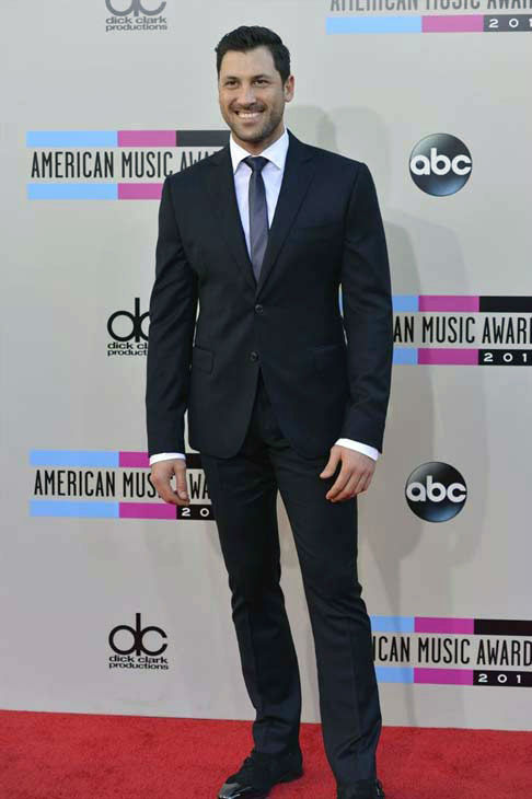 Maksim Chmerkovskiy arrives at the American Music Awards at the Nokia Theatre L.A. Live on Sunday, Nov. 24, 2013, in Los Angeles.