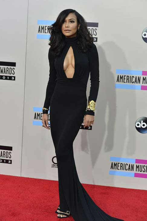 Naya Rivera arrives at the American Music Awards at the Nokia Theatre L.A. Live on Sunday, Nov. 24, 2013, in Los Angeles.