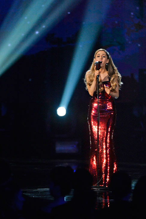 Ariana Grande keeps it simple  Ariana Grande managed to channel both &#39;90s-era Mariah Carey and Jessica Rabbit with her red, strapless, sequined Dolce and Gabbana gown and her simplistic performance of &#39;Tattooed Heart,&#39; which is off her album &#39;Yours Truly.&#39;   It was just Grande on stage with a microphone and four male backup singers -- that was all she needed. Grande ended up taking home the prize for New Artist of the Year. <span class=meta>(ABC Photo&#47; Matt Brown)</span>