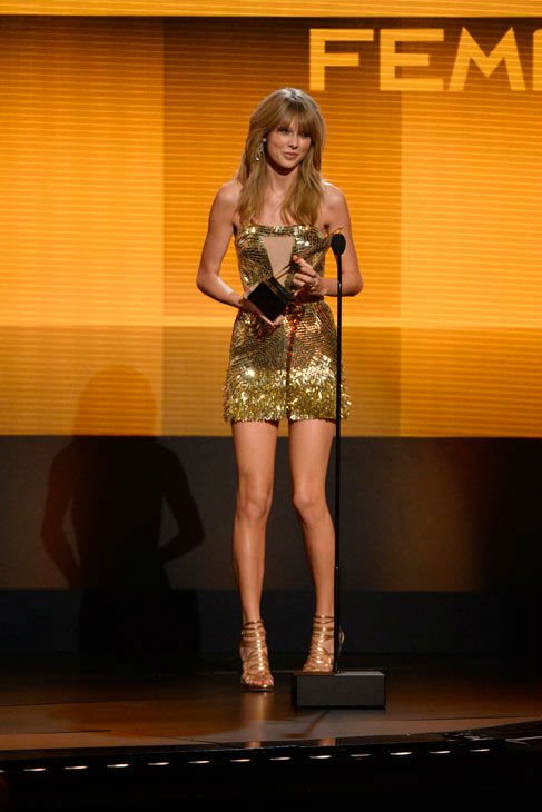 "<div class=""meta ""><span class=""caption-text "">Taylor Swift wins big, dances  Taylor Swift was the big winner of the night, taking home four awards including Artist of the Year, but the singer really scored with her dance moves as the camera kept cutting to her in the groove with some of the performances.   'I have a really good time at award shows,' Swift explained backstage about her dancing. Check out the rest of her answer (including what performances she loved) here. (ABC Photo/ Matt Brown)</span></div>"