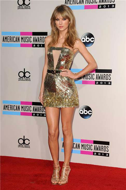 "<div class=""meta image-caption""><div class=""origin-logo origin-image ""><span></span></div><span class=""caption-text"">Taylor Swift appears at the 2013 American Music Awards in Los Angeles, California on Nov. 24, 2013.  (Kyle Rover / startraksphoto.com)</span></div>"