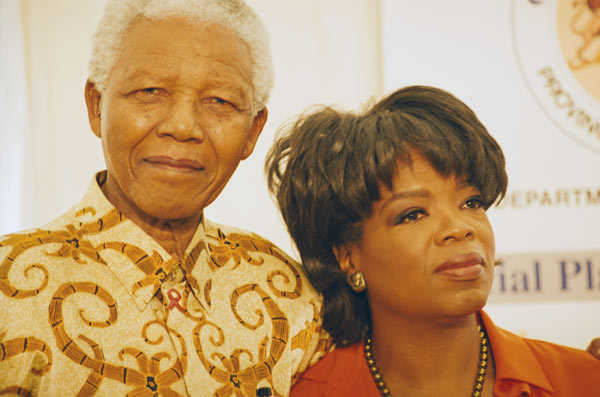 Oprah Winfrey and Nelson Mandela appear in an undated photo provided by Winfrey.