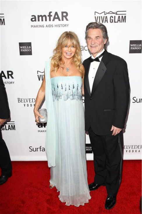 Goldie Hawn and longtime partner Kurt Russell appear at the 2013 amfAR Inspiration Gala in Los Angeles on Dec. 12, 2013. The two have been together since the early 1980s and share a son, Wyatt, while Hawn has a son and daughter, Oliver Hudson and actress Kate Hudson, from a past marriage.  <span class=meta>(David Wright &#47; Startraksphoto.com)</span>