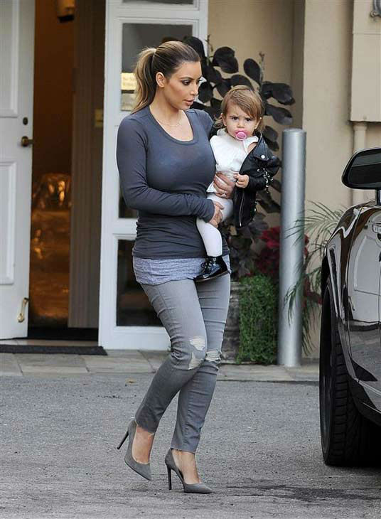 Kim Kardashian holds niece Penelope Disick while out in Beverly Hills, California, on Dec. 16, 2013.