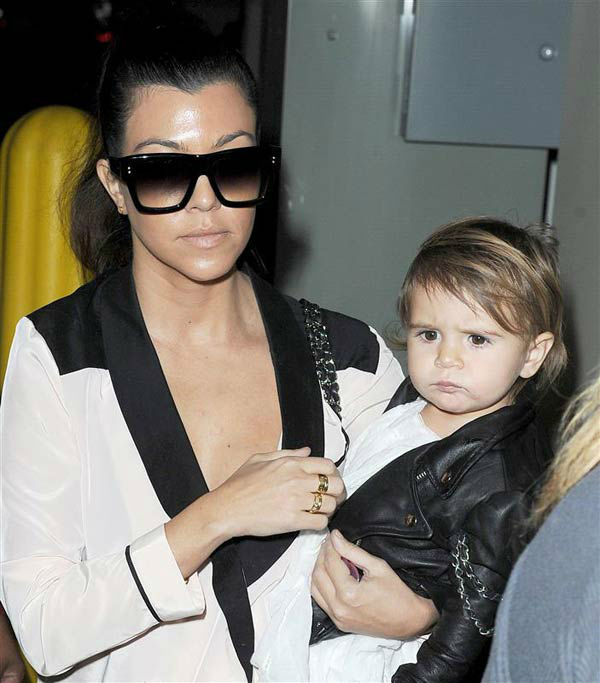 Kourtney Kardashian and daughter Penelope Disick are seen out in Beverly Hills, California, on Dec. 16, 2013.