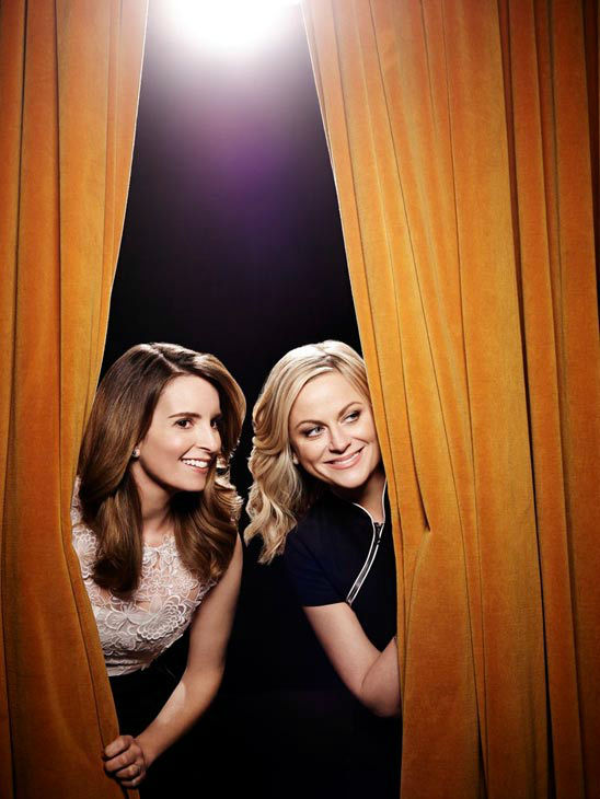 Amy Poehler and Tina Fey appear in a 2014 promotional photo for the 71st Annual Golden Glob