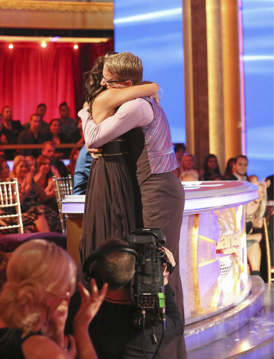 Actor and comedian Andy Dick hugs judge Carrie Ann Inaba after she was moved to tears by his and partner Sharna Burgess&#39; Viennese Waltz during week 4 of season 16 of &#39;Dancing With The Stars&#39; on April 8, 2013. He had dedicated the dance to his 15-year-old daughter. Inaba had lost her father in March. <span class=meta>(ABC Photo &#47; Adam Taylor)</span>