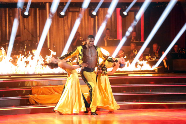 "<div class=""meta image-caption""><div class=""origin-logo origin-image ""><span></span></div><span class=""caption-text"">NFL star Jacoby Jones and partner Karina Smirnoff dance a Paso Doble trio with Cheryl Burke on week eight of 'Dancing With The Stars' on May 6, 2013. They received 25 out of 30 points from the judges. The pair received 27 out of 30 points for their previous dance on this episode, the Viennese Waltz. Their total for the night was 52 out of 60. (ABC Photo / Adam Taylor)</span></div>"