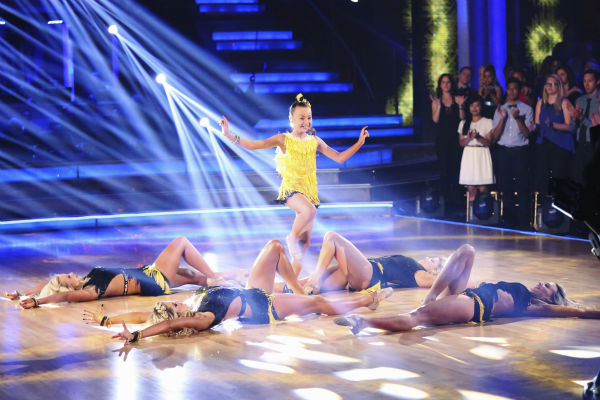 "<div class=""meta ""><span class=""caption-text "">'AT and T Spotlight Performance' returns for its final installment, which features 10-year-old Sophia Lucia, who set the Guinness World Record for consecutive pirouettes, on 'Dancing With The Stars: The Results Show' on May 14, 2013. Also pictured: Pro dancers Lindsay Arnold, Chelsie Hightower and Witney Carson. (ABC Photo / Adam Taylor)</span></div>"