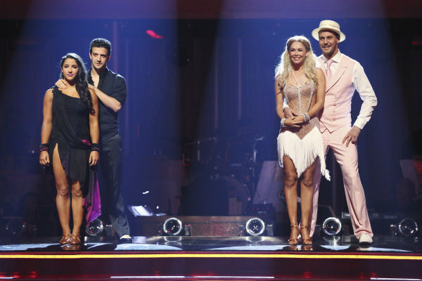 Aly Raisman and Mark Ballas and Ingo Rademacher and Kym Johnson await their fate on &#39;Dancing With The Stars: The Results Show&#39; on May 14, 2013. <span class=meta>(ABC Photo &#47; Adam Taylor)</span>