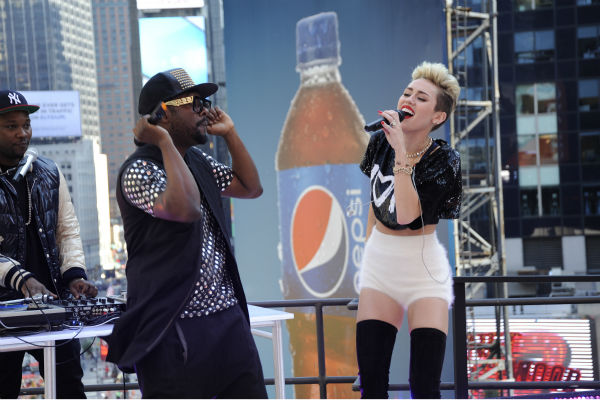 "<div class=""meta image-caption""><div class=""origin-logo origin-image ""><span></span></div><span class=""caption-text"">Miley Cyrus and will.i.am perform live on ABC's 'Good Morning America' on June 26, 2013. (Donna Svennevik / ABC)</span></div>"