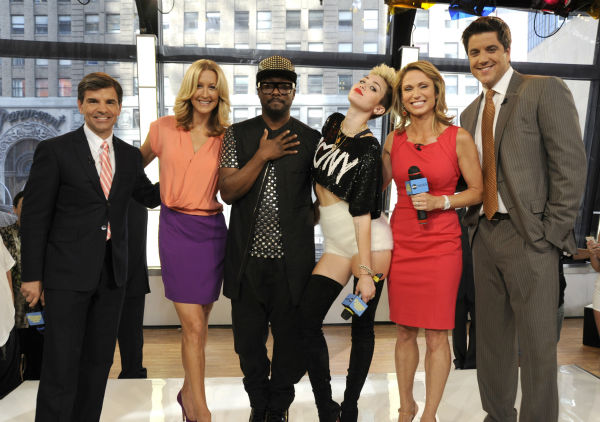 Miley Cyrus and will.i.am appear with George Stephanopoulos, Lara Spencer, Amy Robach and Josh Elliot on ABC's 'Good Morning America' on June 26, 2013.