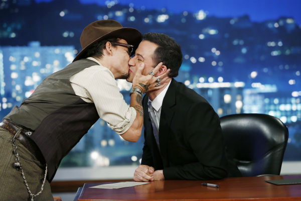 Johnny Depp kisses host Jimmy Kimmel on the ABC late-night talk show 'Jimmy Kimmel Live!' on July 1, 2013. Depp appeared on the program to promote the new Disney film 'The Lone Ranger,' in which he plays Tonto.
