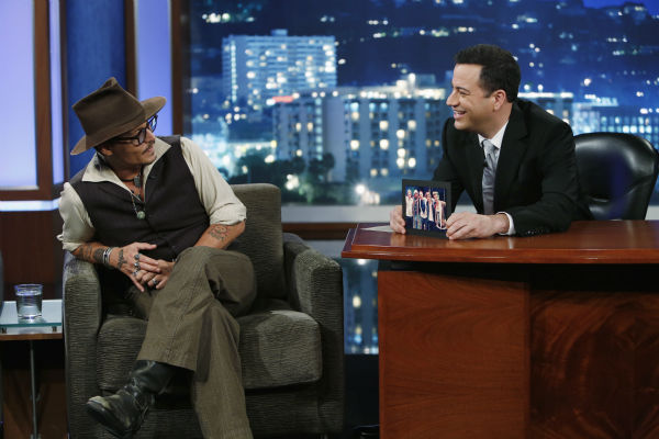 Johnny Depp talks to host Jimmy Kimmel on the ABC late-night talk show 'Jimmy Kimmel Live!' on July 1, 2013. Depp appeared on the program to promote the new Disney film 'The Lone Ranger,' in which he plays Tonto.
