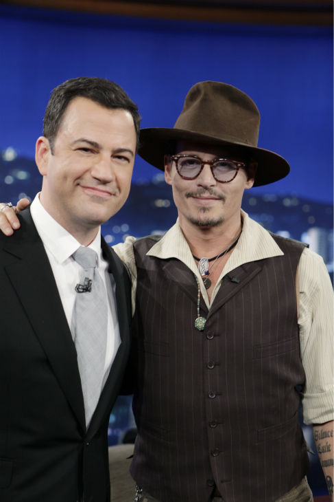 Johnny Depp poses with Jimmy Kimmel, host of the ABC late-night talk show 'Jimmy Kimmel Live!' on July 1, 2013. Depp appeared on the program to promote the new Disney film 'The Lone Ranger,' in which he plays Tonto.