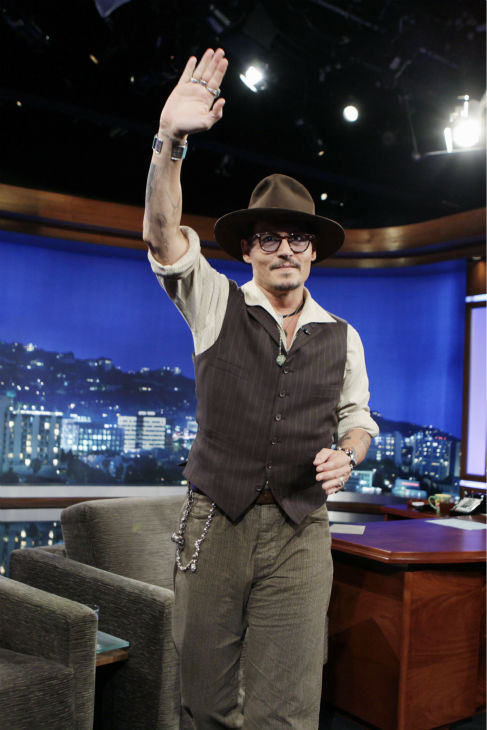 Johnny Depp waves to the studio audience of the ABC late-night talk show 'Jimmy Kimmel Live!' on July 1, 2013. Depp appeared on the program to promote the new Disney film 'The Lone Ranger,' in which he plays Tonto.